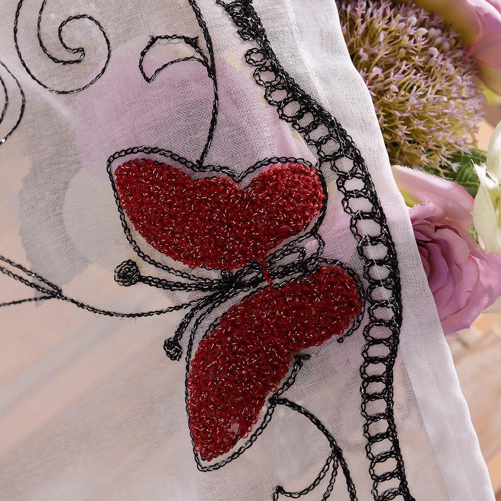 Rideau à motifs papillon