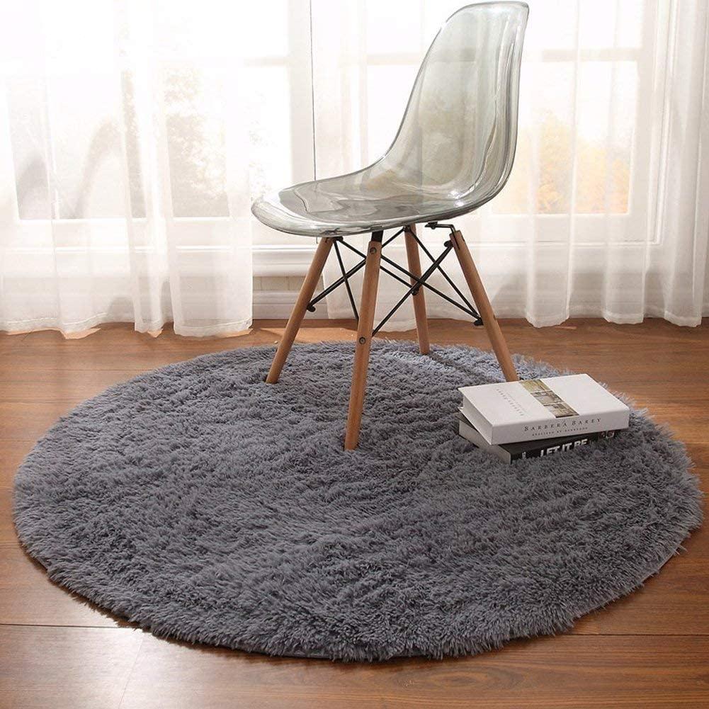 Tapis rond et moelleux de décoration pour salon ou salle à manger